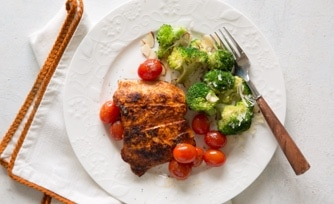 Grilled Chicken Breasts with Spinach-Tomato Sauté